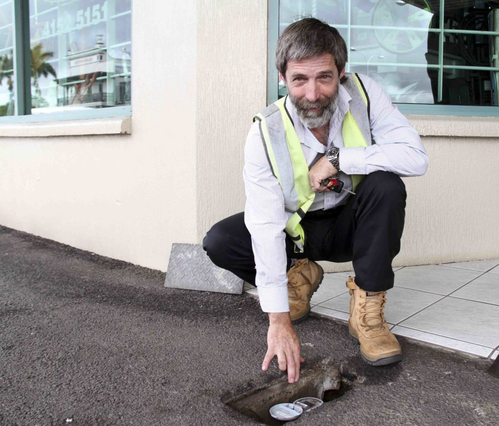 Geoff Tansley with a recently installed smart water meter