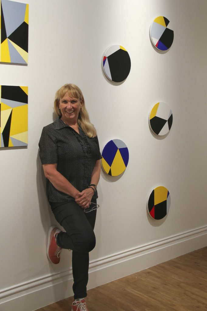 Judith Duquemin with her exhibition Geometry and Place at Bundaberg Regional Art Gallery.