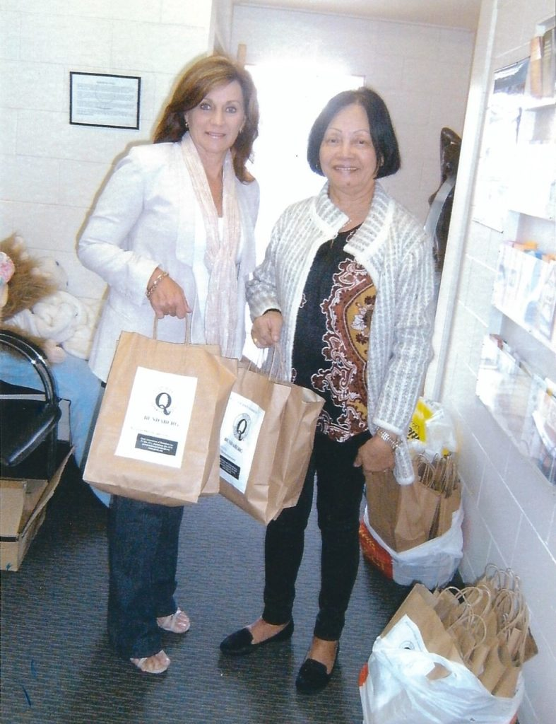 Lyne Booth of Edon Place accepting Personal Care Packs from Quotarian  Dympna Kimmorley.
