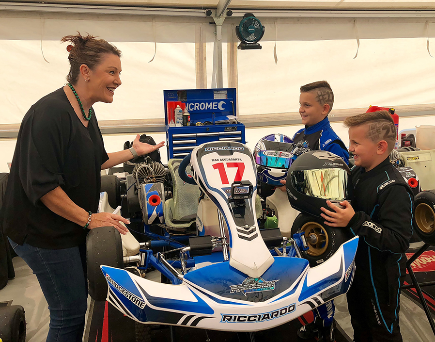 Cr Helen Blackburn chats with Oliver and Max Acquasanta about their karts.