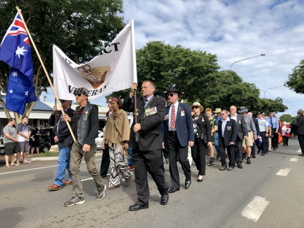 Woodgate Anzac reflection, ex service personnel marching in Childers.