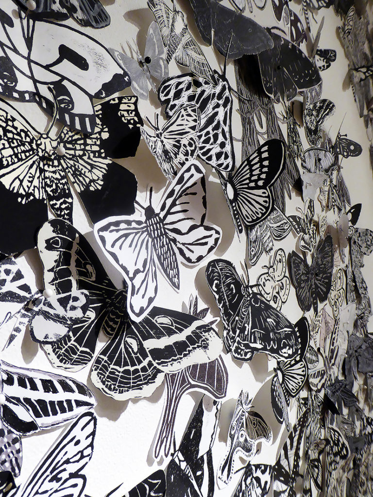 The Moth Migration Project features thousands of hand-drawn paper moths.