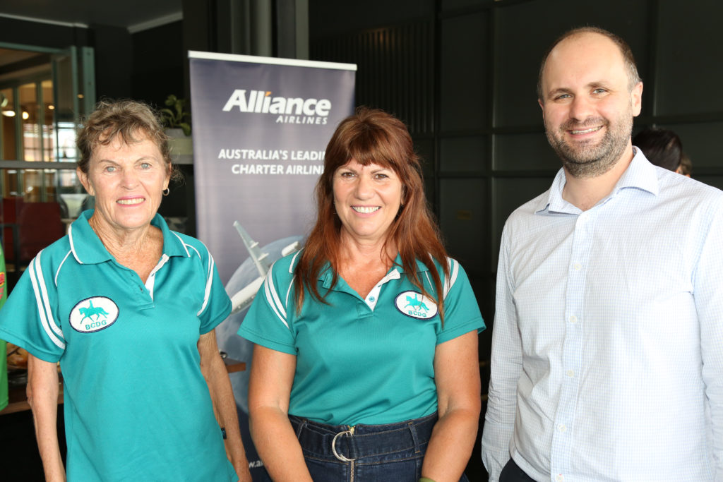 Bundaberg Country Dressage Club Committee Member Annika Croaker and Treasurer Susan Draganoff with Alliance Airlines National Charter Sales Manager Alex Ananian-Cooper.
