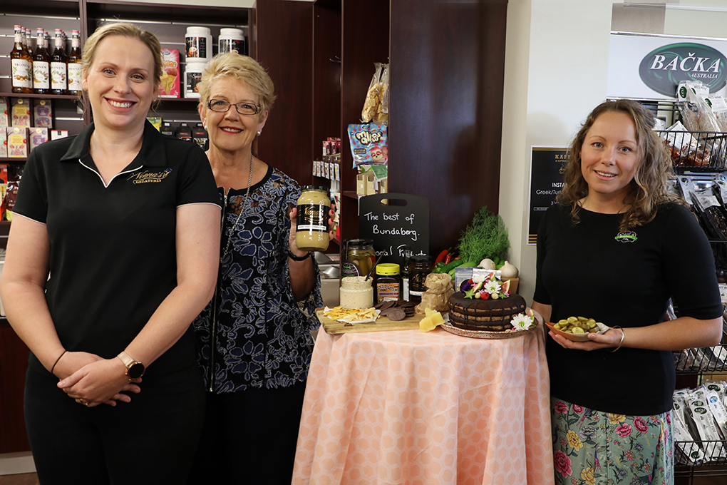 Council's Community Services portfolio spokesperson Cr Judy Peters (middle) joins stallholders Leisa Storey, from Nana's Pantry, and Melissa Baker, from Well Goodness Me, to launch the 2019 Bundy Flavours event.