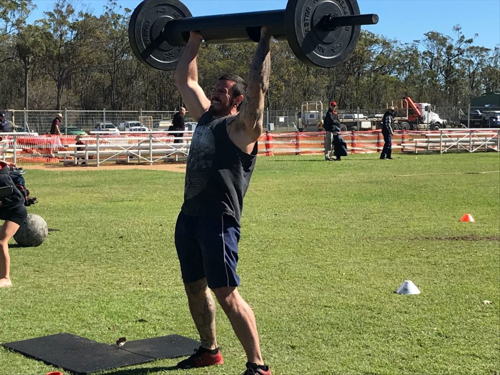 Agrotrend Strongman Sean Maher powers through the log lifts.