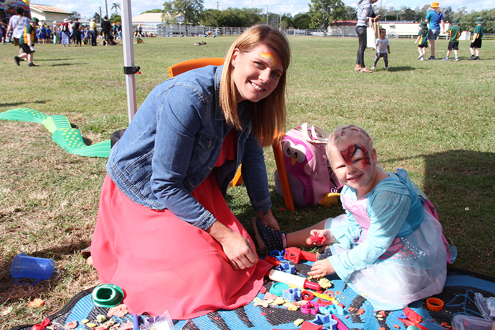 Kauri and Kaylyn enjoy the Bush Kids stall at the Gin Gin Family Fitness Day.