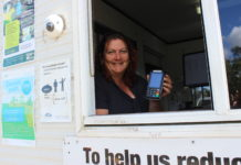 Landfill attendant Marcie Petterson with the new eftpos machine at University Drive Waste Facility