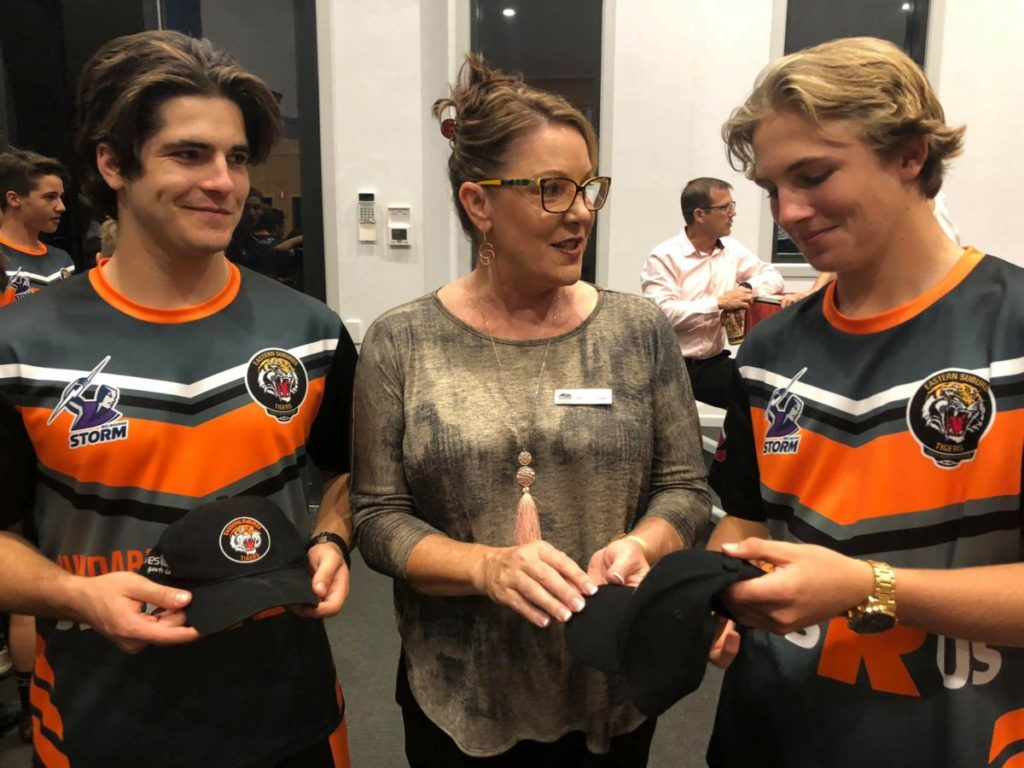 Cr Helen Blackburn with Eastern Suburbs Tigers Wide Bay Development Academy players Brendan Grills and Harrison Bull.