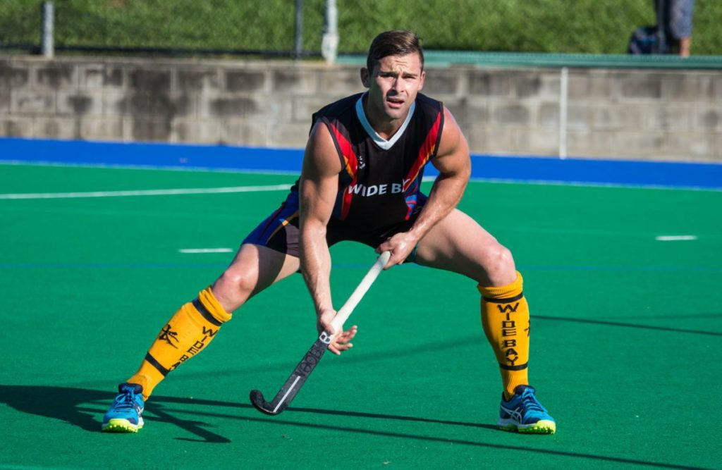 Bundaberg hockey player Cale Cramer in action for Wide Bay Thunder