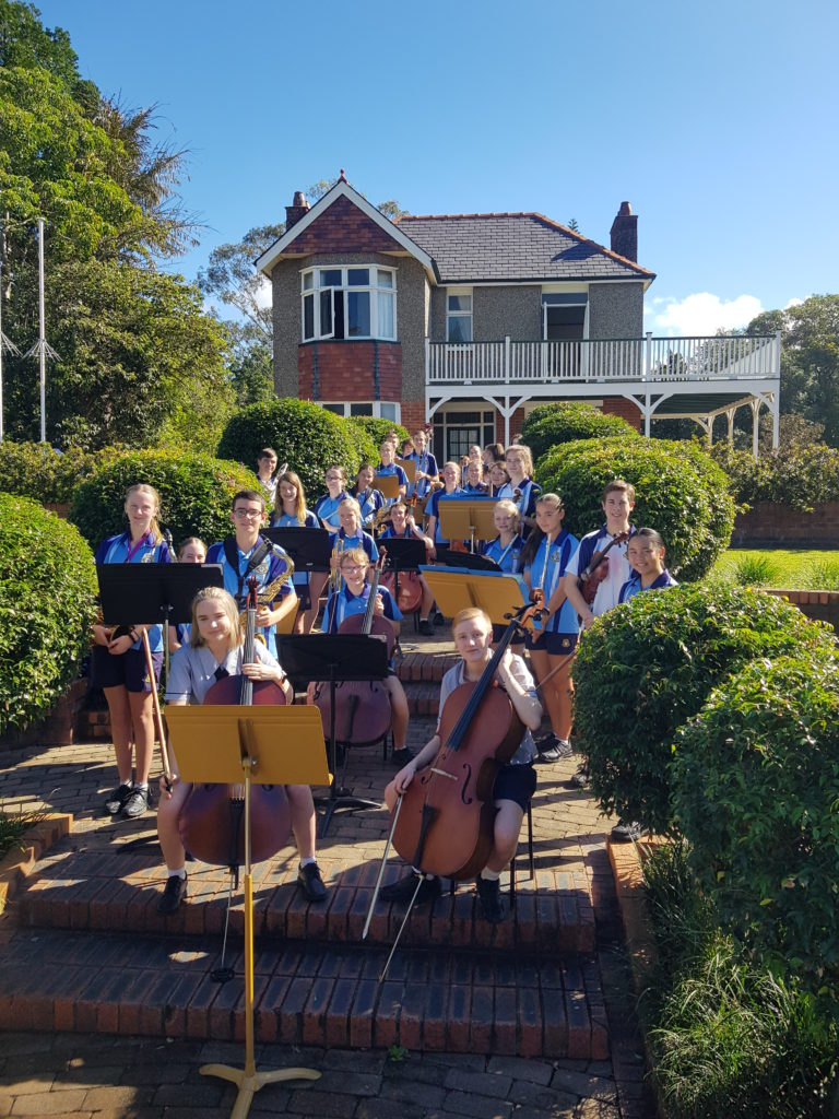 Bundaberg State High School students performing in front of Bert Hinkler's house