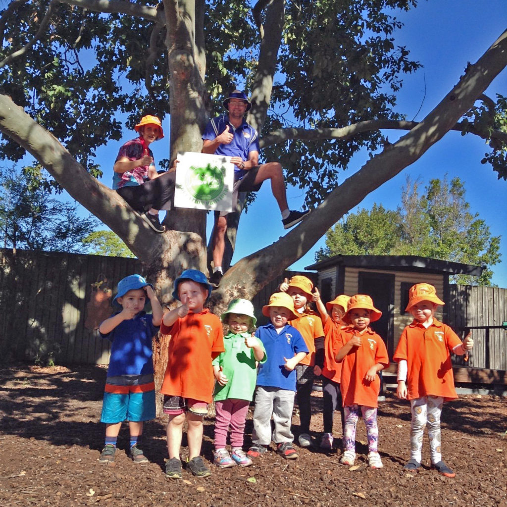Frogtastic kindergarten teachers Kristy Ramsay and Scott Chambers celebrate their Nature Play accreditation with the kindy kids.