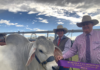 Clint Whitaker and Cr Wayne Honor with the Grey Brahman that took out junior champion bull in the stud cattle event at Gin Gin Show