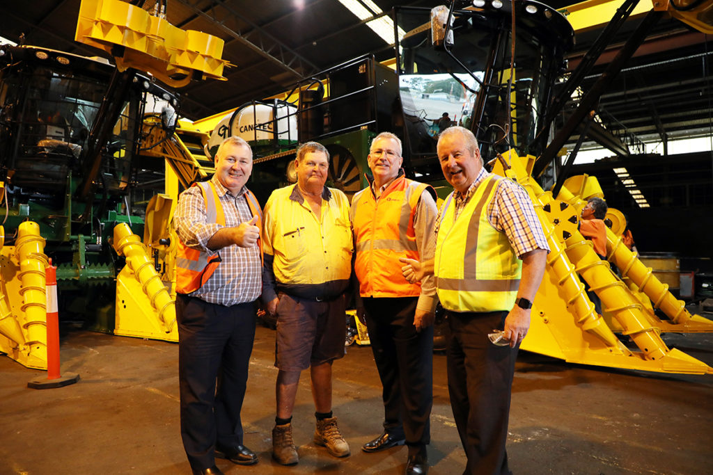 Mayor Jack Dempsey and Cr Steve Cooper join harvester Garry Walk and Canetec General Manager Glenn Soper to view the new AX9000 models.