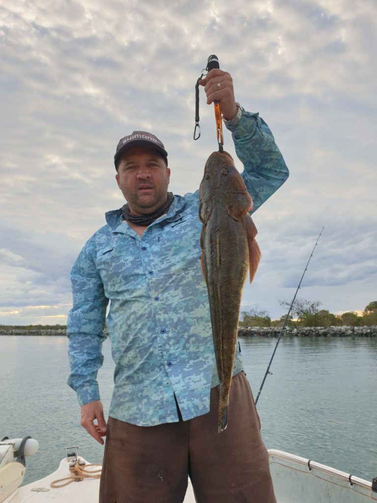 Michael Gallagher on the Burnett River with a flathead.