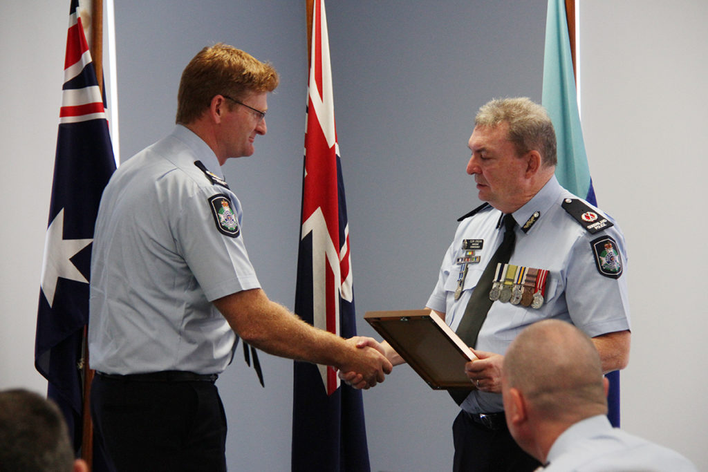 Bundaberg Police awards: Senior Sergeant Glenn Cameron receives and award from Assistant Commissioner Clem O'Regan.