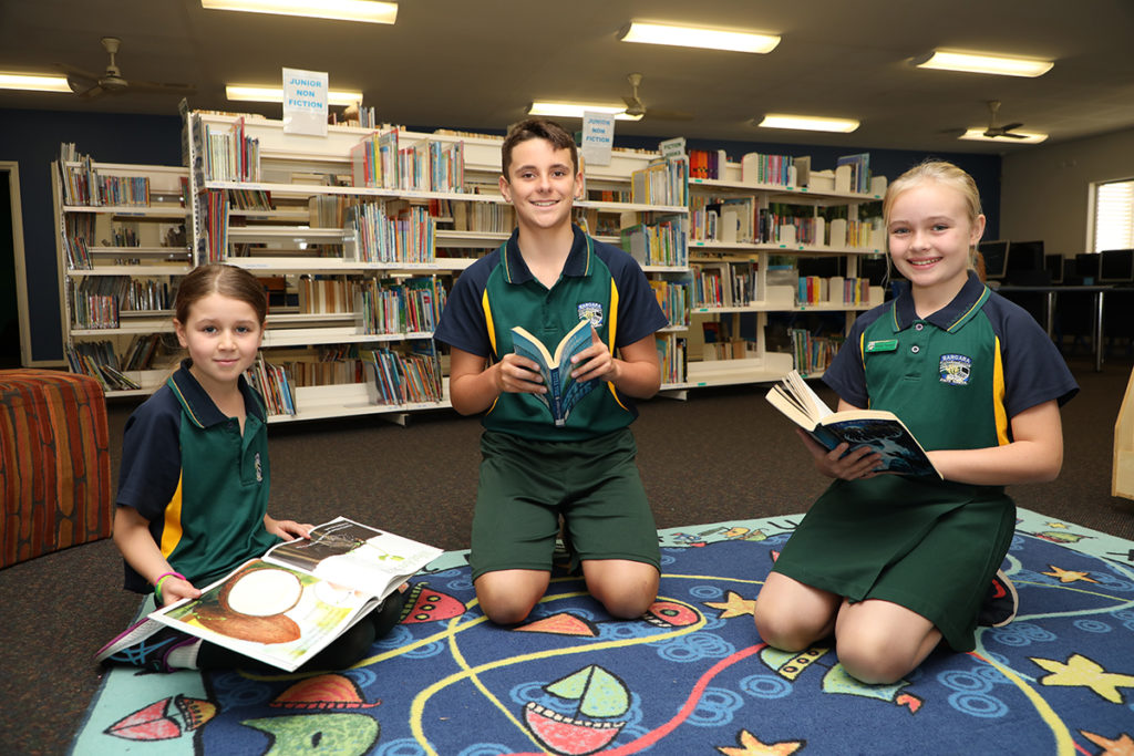 Hailey Randell, Tommy Zunker and Makyla Thompson love their reading at Bargara State School Library.