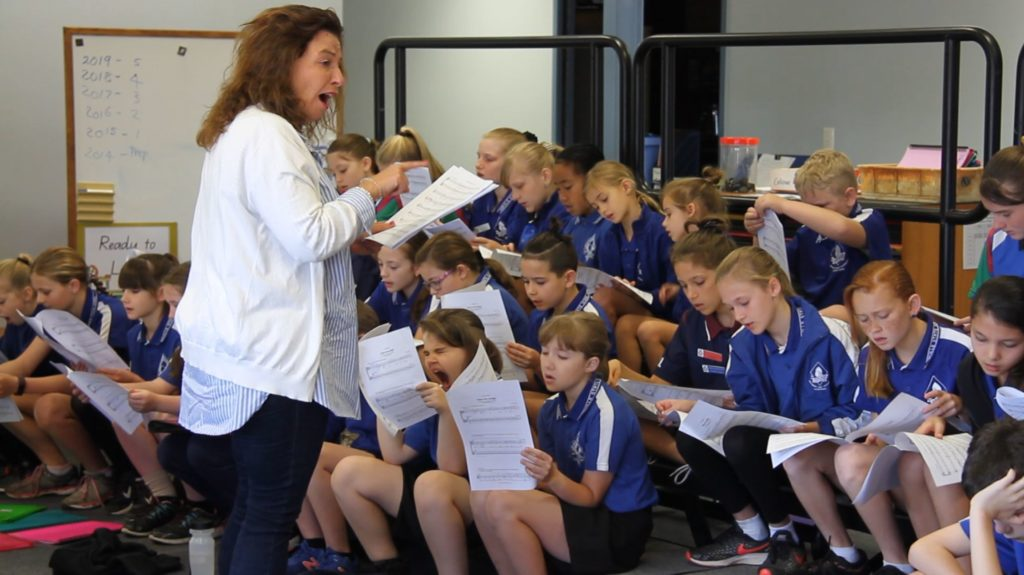 Michelle Leonard OAM with Norville State School students for a choir workshop