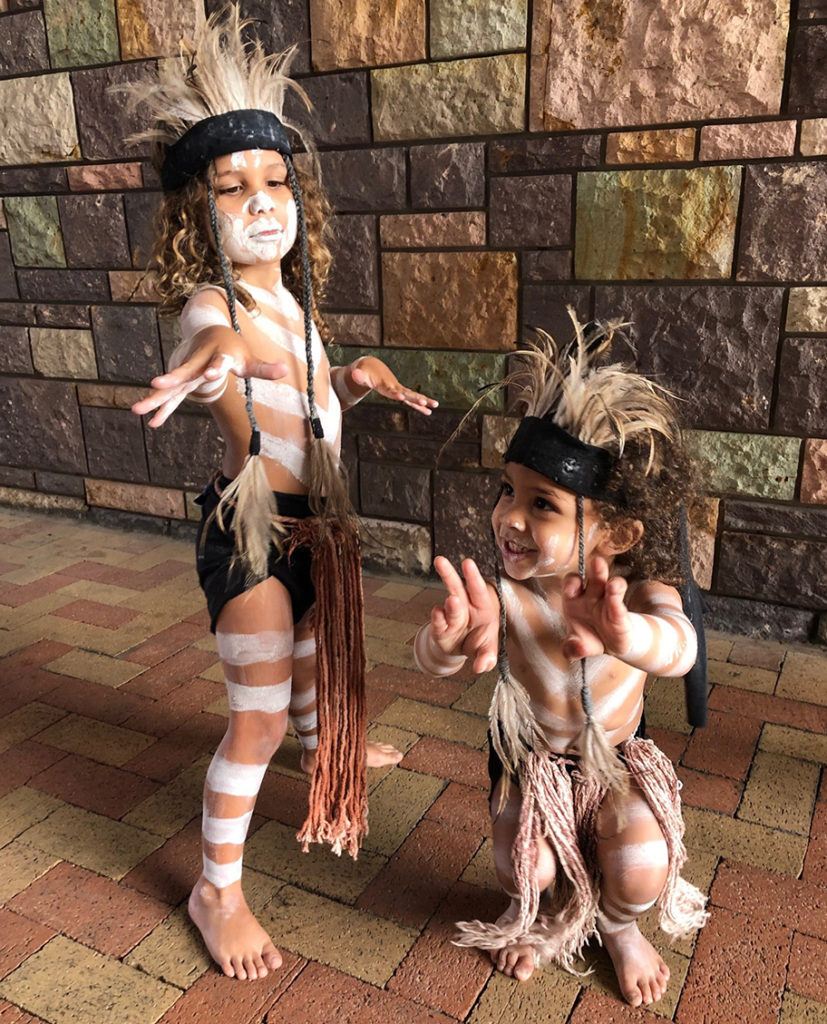 Two very cute performers getting ready to dance at the NAIDOC Week flag raising ceremony.
