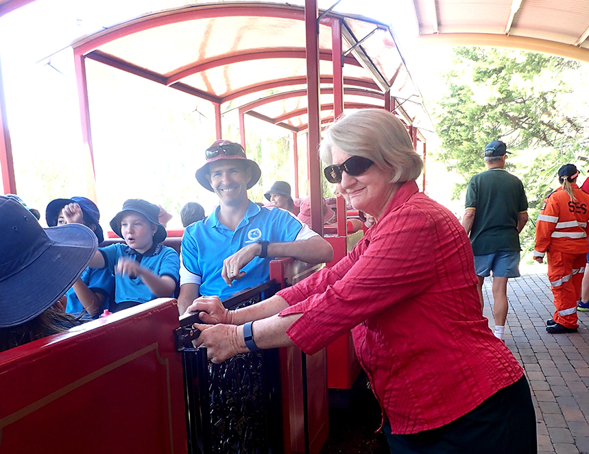 HOLIDAY FUN: Therese makes sure all passengers are ready to ride.