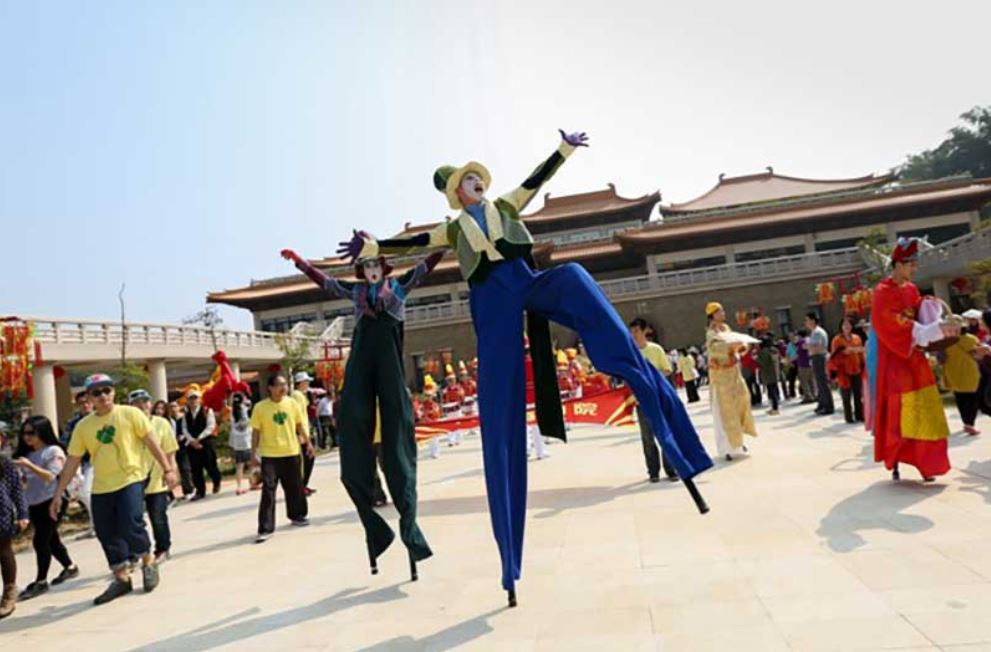 Look up! Stilt walkers will be wandering through the crowds on festival day.