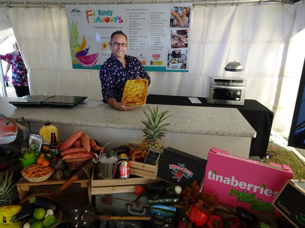 Windmill Café owner Joey Caruana at Bundy Flavours with seafood lasagne