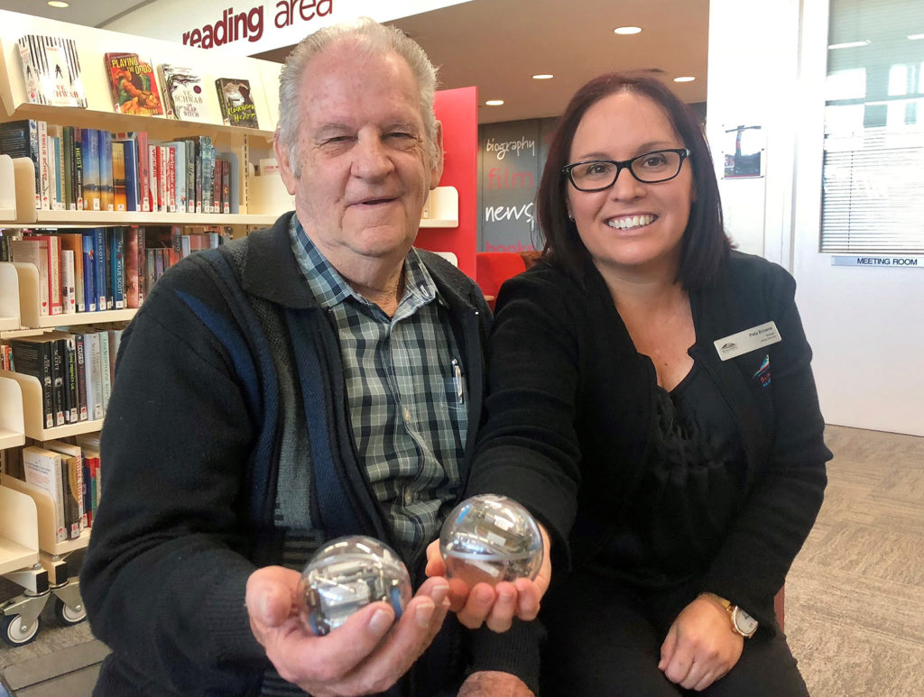 President of Friends of the Library Bob Adam and Bundaberg Library manager Peta Browne with some Sphero robots.