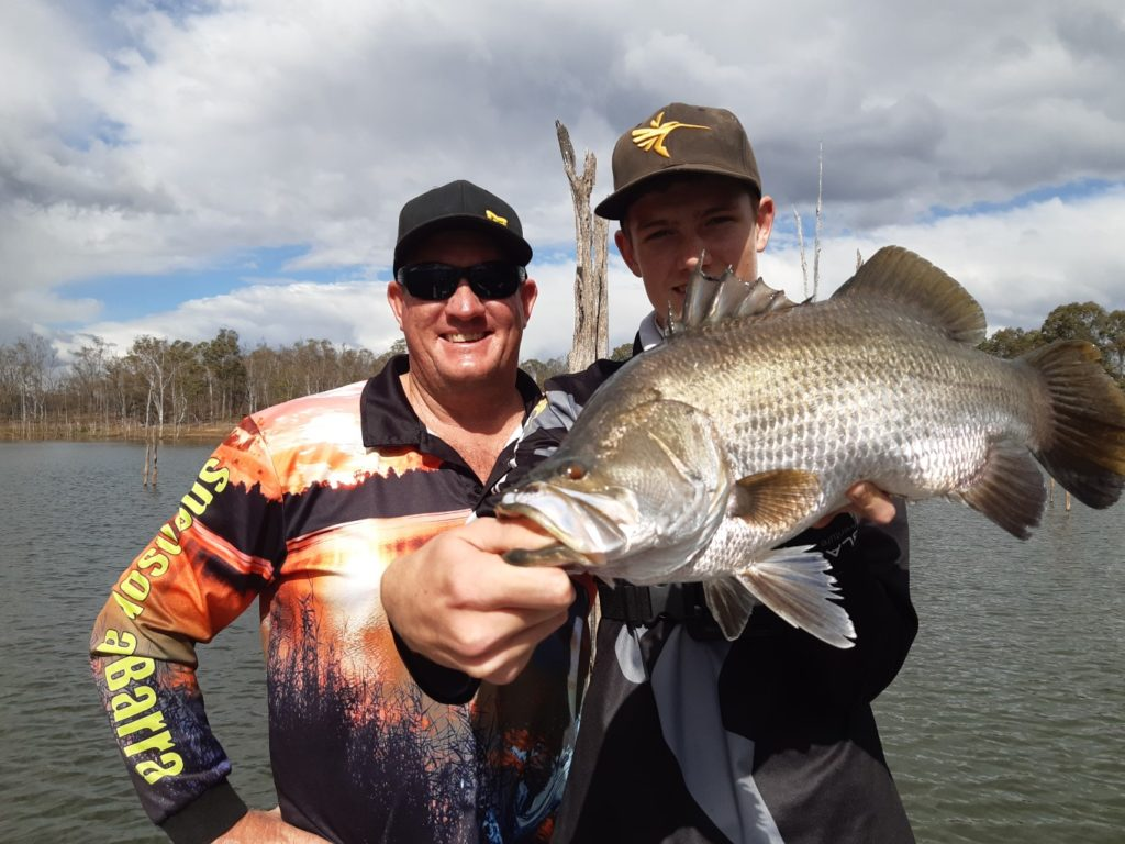 Dale and Matthew Smith with a 65cm Lake Monduran barra.