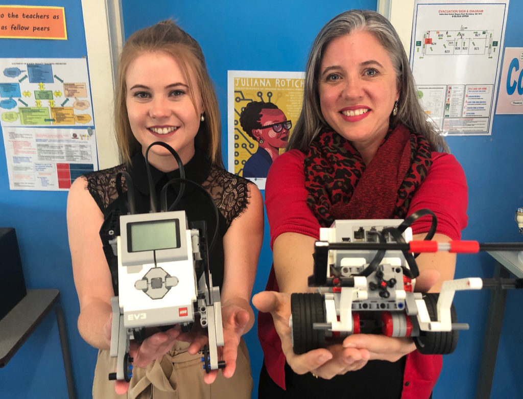 Bundaberg East State School's Melinda Clancy and Kalkie State School's Samantha Ephraims with the robots they use in the classroom.