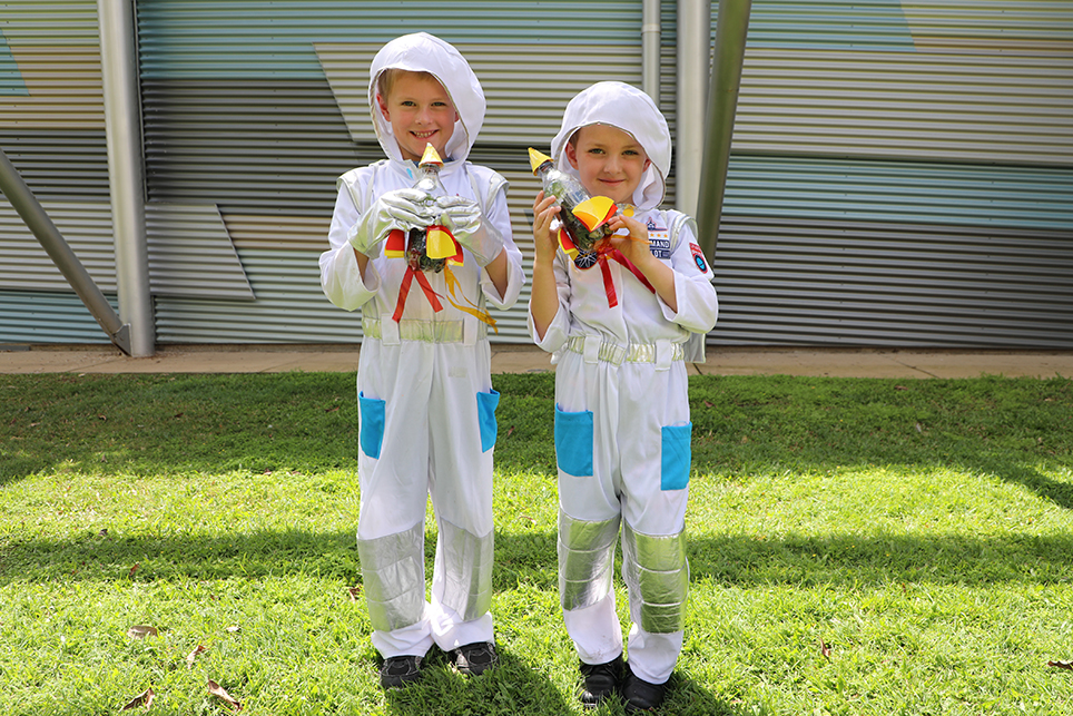 LITTLE ASTRONAUTS: Nathan and Alistair Job dressed up for the Rocket Ship Planter workshop at the Hinkler Hall of Aviation in the Botanic Gardens today.