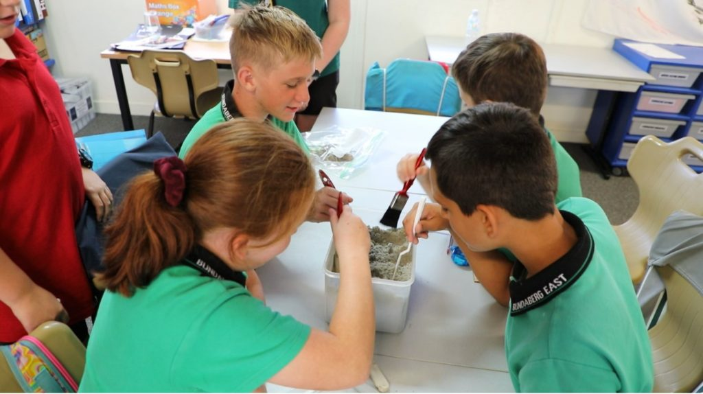 Bundaberg East State School students taking part in Shoe Box Archaeology as part of State Education Week.
