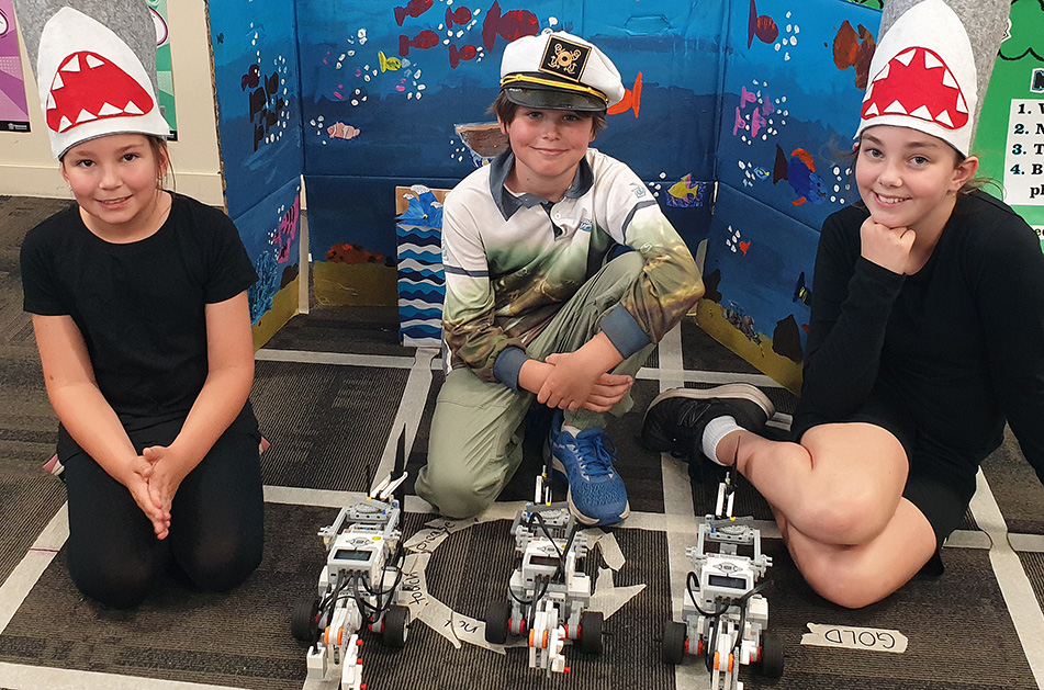 Bundaberg East State School students Chloe Rawson, Finn Heads and Charlotte Baker are heading to the RoboCup Nationals in Melbourne this week.