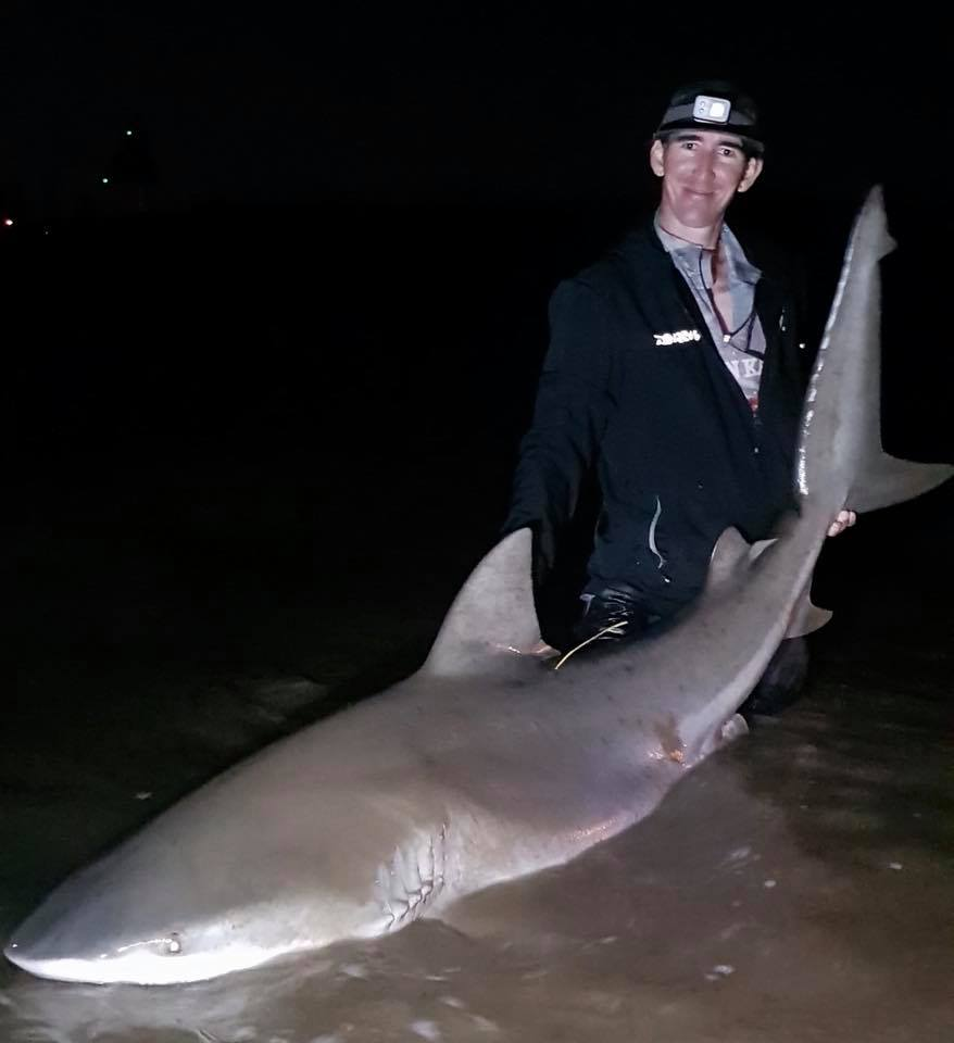 Jesse Spence with a 7ft 5 bull shark he caught in the Burnett River last week.