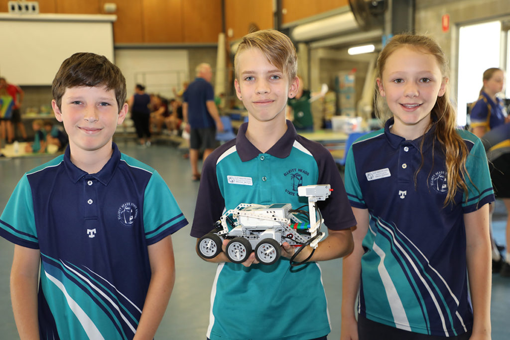 Thomas Wicks, Mitchel Morgan and Sienna Haselden from Elliot Heads State School compete in the Robocup Competition.
