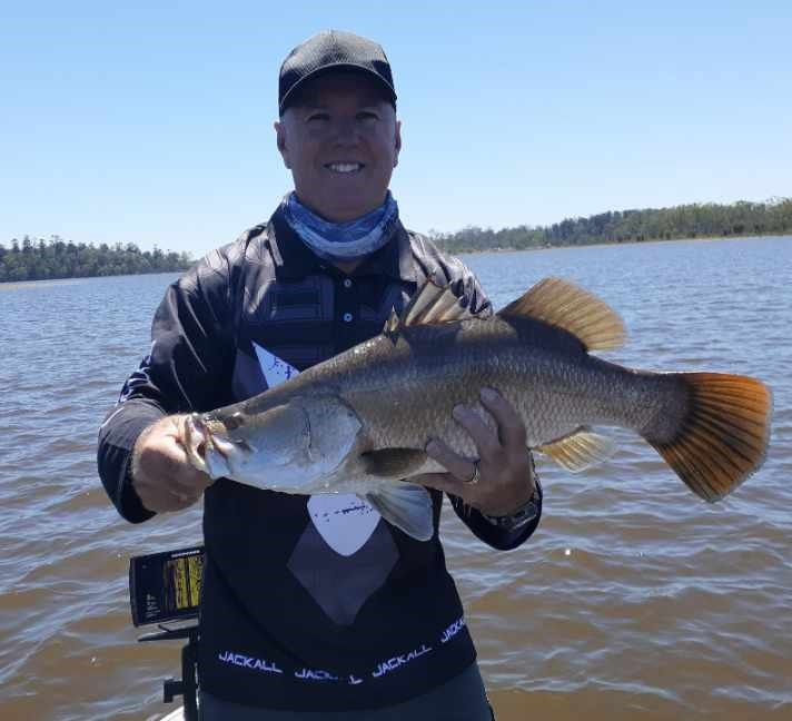 Shane Anderson with the nice barramundi he caught at Lenthalls Dam recently.