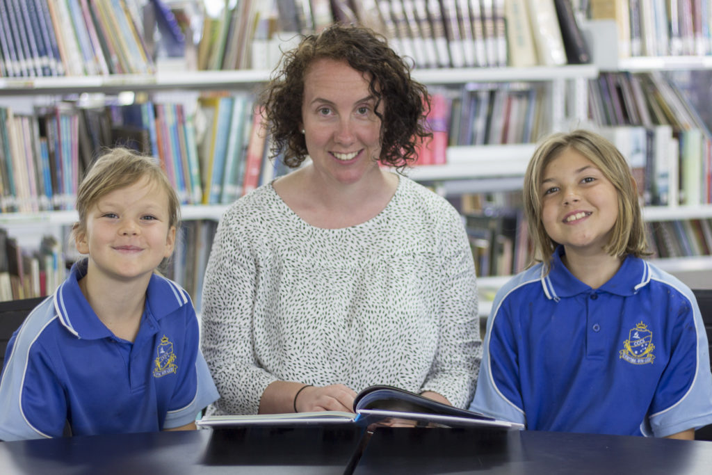 Coral Coast Christian School's new principal Mrs Kristy Norman with two students.