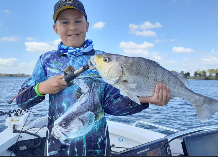 Ashton Anderson with the 56cm grunter he caught recently.