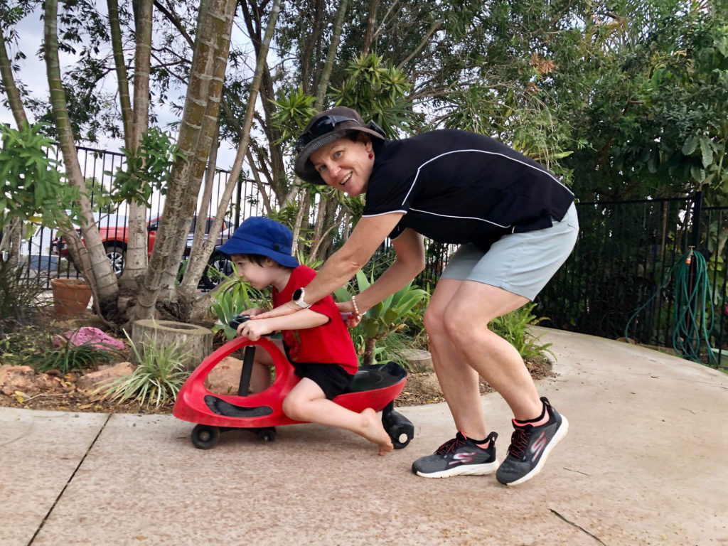 Steady as you go! Kindy director Rhonda Campbell ensures Jayden Pedemont negotiates the bicycle path safely.