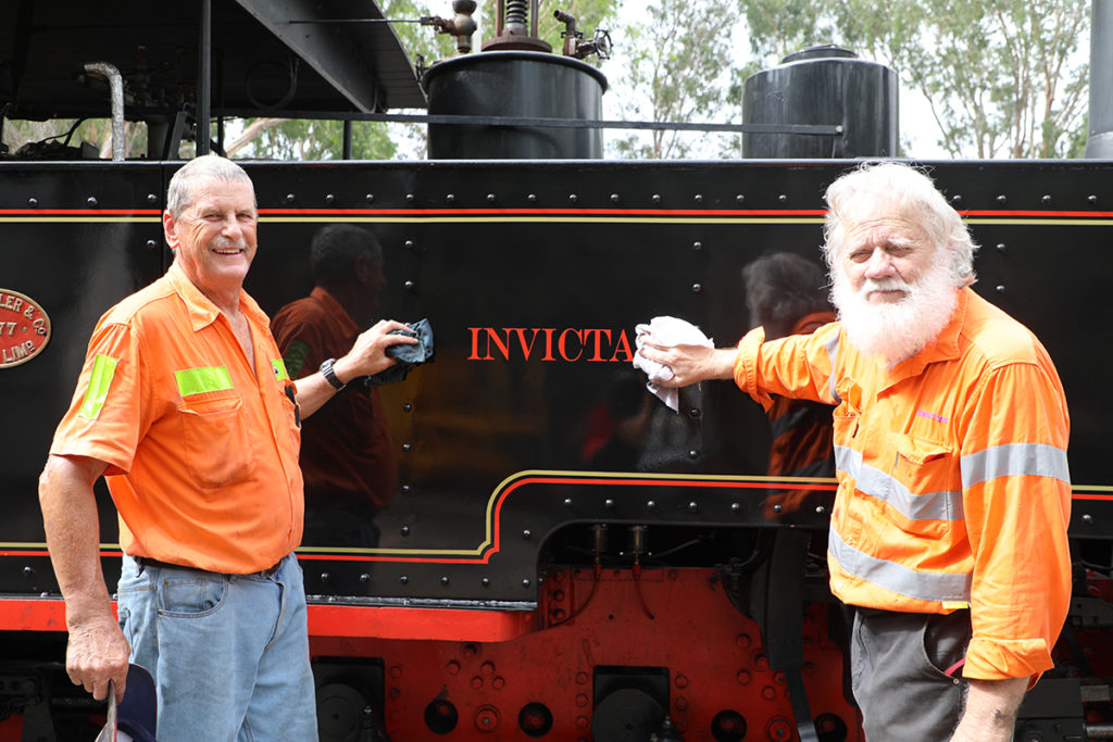 Phil Partridge and Ross Driver giving one of the locomotives a final clean before Sunday.