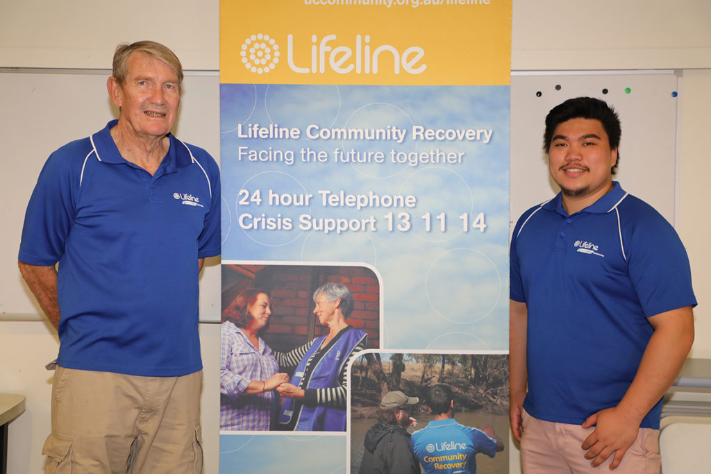 Bill Fisher and Ishrel Lequin volunteer at Bundaberg Lifeline