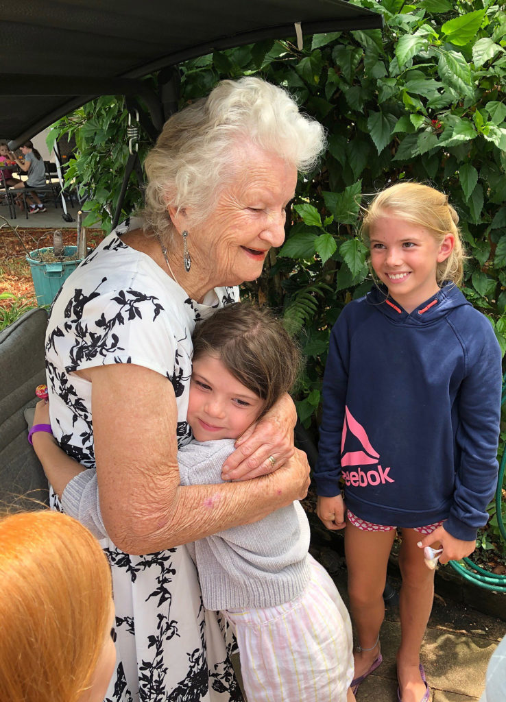 Priceless. Barb receives a hug from Miley Ludke following a visit to the Fantasy Garden.