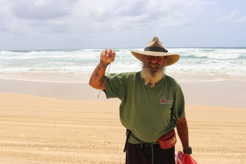 Ray Smith with his first ever beach worm at Fraser Island.