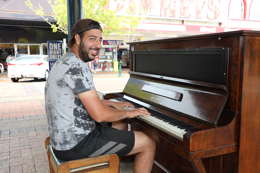 Malek Kas from Paris checks out the new community piano in the Bundaberg CBD.