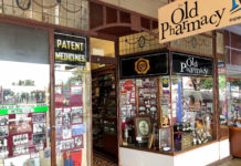 Sport and sporting achievement forms a themed window display at the Old Pharmacy in Childers.