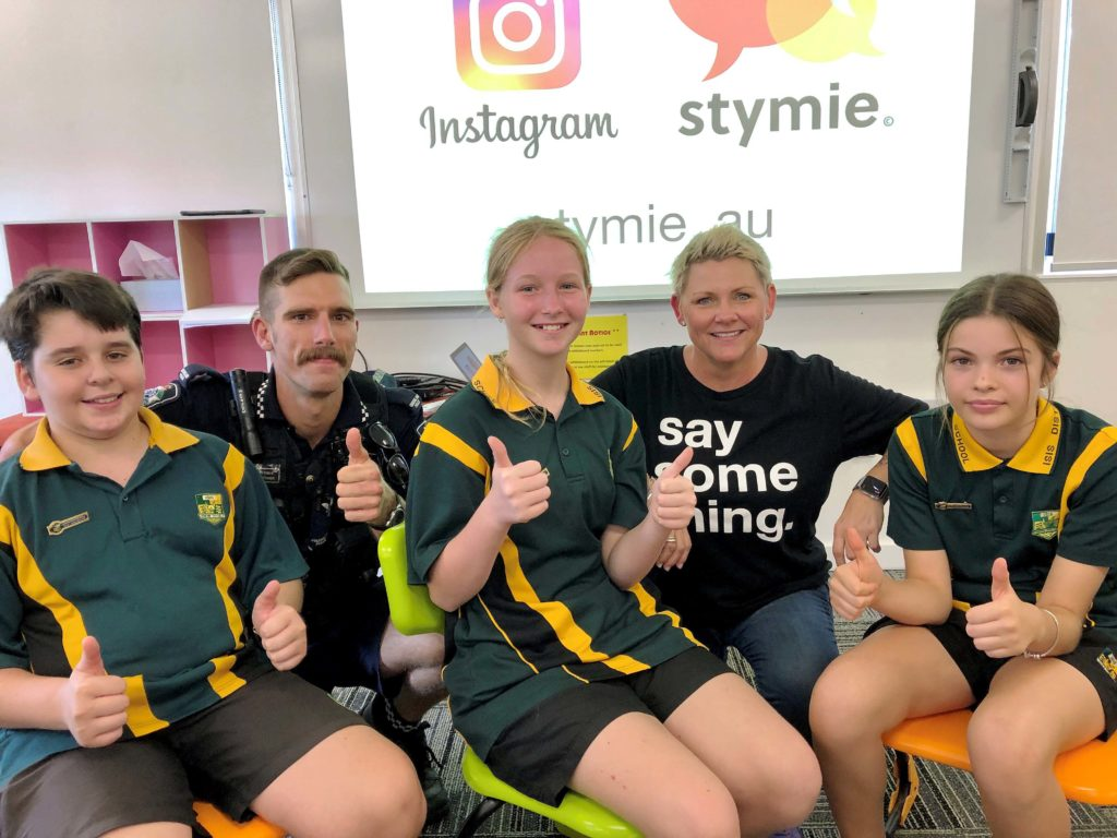 Students at Isis District State High School (from left) ??????, ????????? and ??????? join with Childers Police Constable Rohin Power in showing approval to STYMIE developer Rachel Downie for her presentation at the school this week.