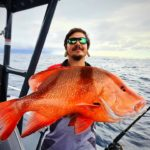 Jay Balazs with the cracker red emperor he caught off Burnett heads recently.
