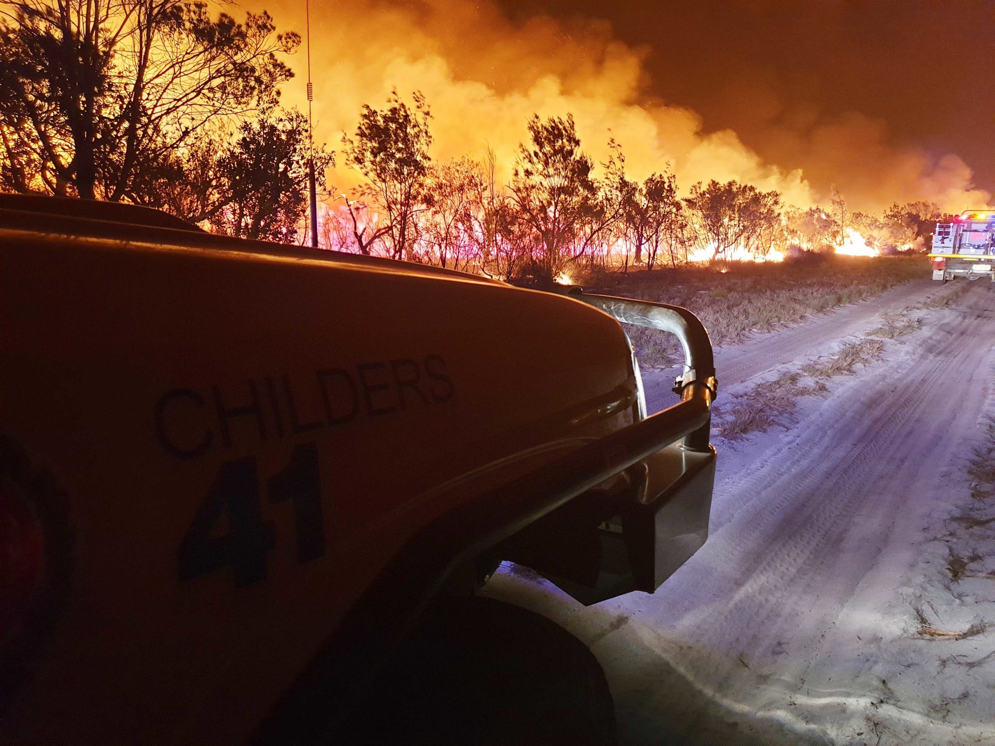 Childers fire crews in action during the November 2019 fires in the Burrum Coast National Park near Woodgate Beach.