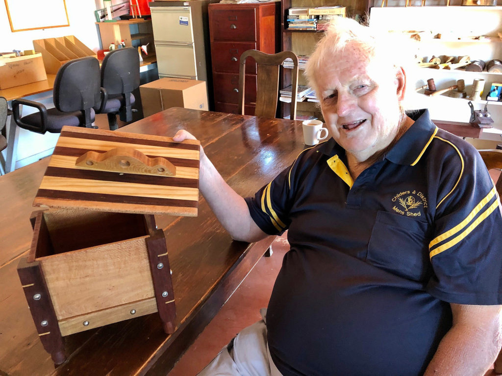 Peter Englart with a piece he is currently working on during his mornings at the Childers Men's Shed.