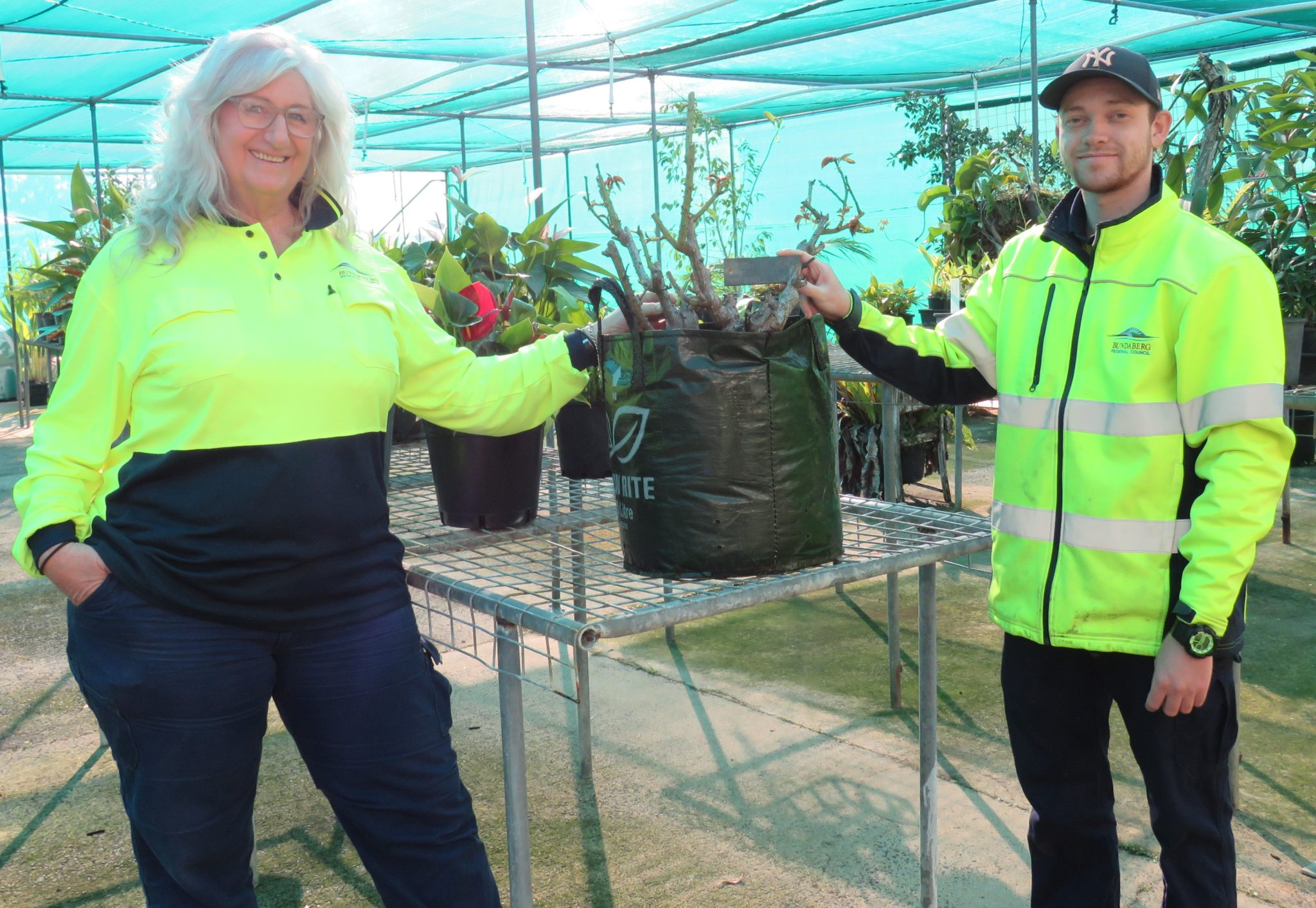 Nursery Manager Diane Southwell and Horticulture trainee Darien Doyle with one of the rose bushes at the Botanic Gardens Nursery.