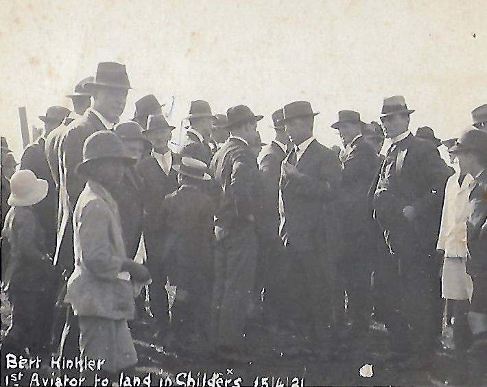 Surrounded by an adoring crowd, Bert Hinkler (depicted by a white X above the word Childers) chats with local dignitaries during his visit to Childers when he landed at the local showgrounds.