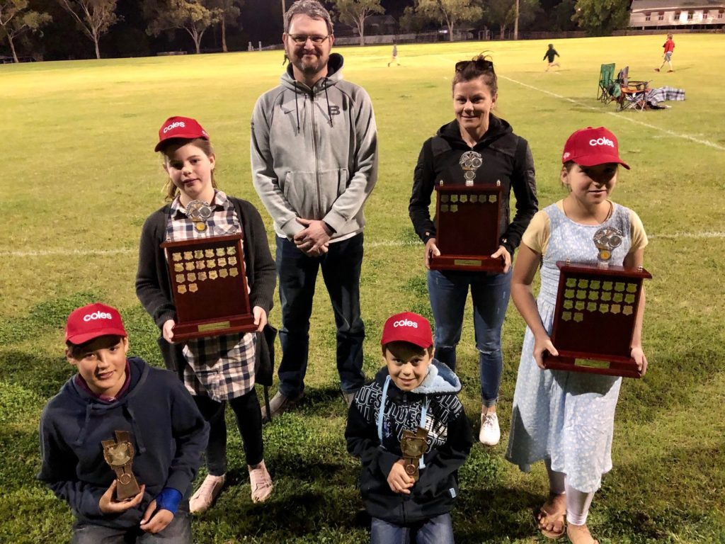 Age group champions at the Isis District Little Athletics for the 2019-20 season are (from left) Jake Hardy and Alicia Ebert (Juniors); Michael Ebert and Charli Murton (Seniors) and Martyn Ryan and Emily Hardy (Adult).